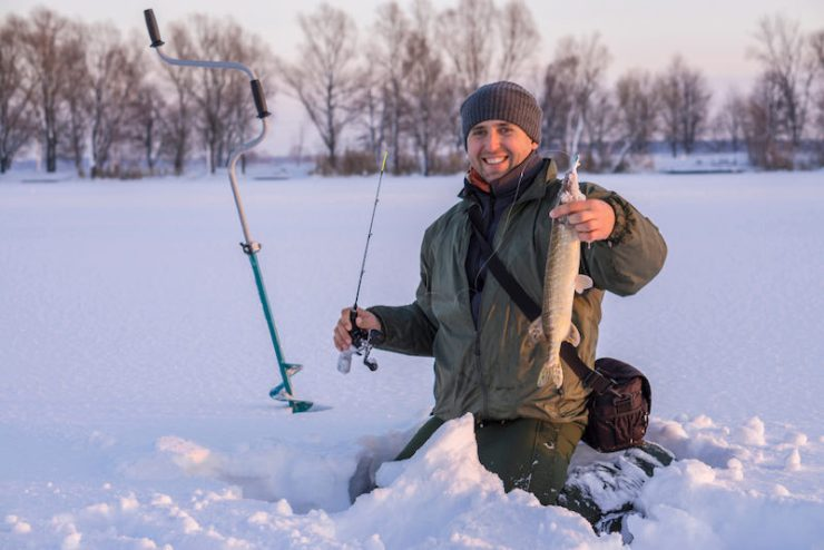 winter fishing concept | ice fishing shack