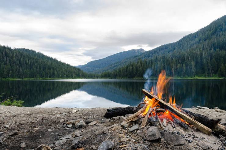 Landscape of a campfire in a peaceful lake valley | Bow drill kit