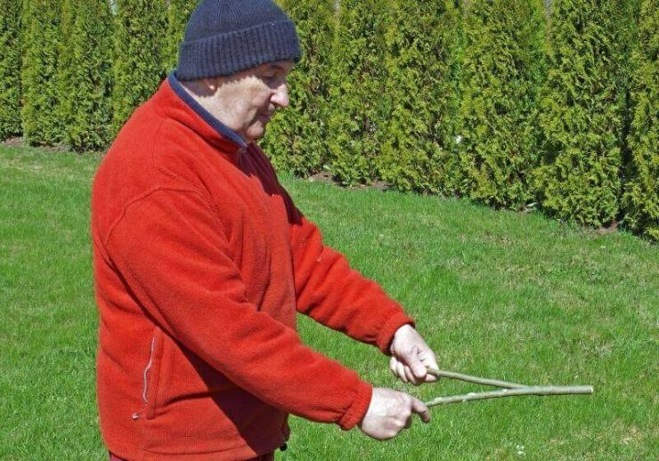 Senior man search divining with the rod | 3 Great Ways To Use Dowsing Rods