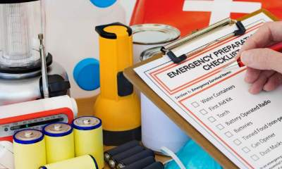 Hand completing Emergency Preparation List by Equipment | Prepare Your Family for Emergencies | Featured