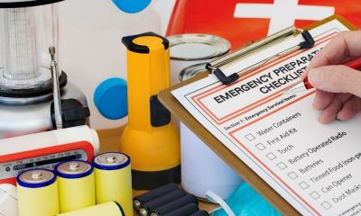 Hand completing Emergency Preparation | Building a Power Outage/Blackout Kit | Featured
