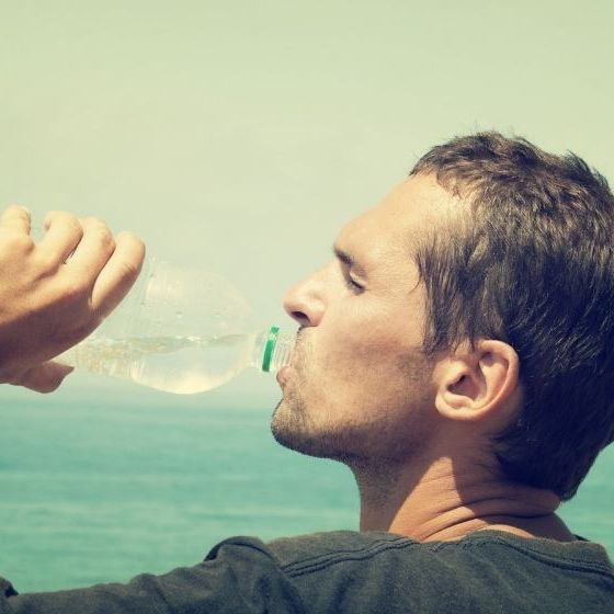 Man drinking water hot day | How To Make Seawater Drinkable Using Plastic Bottle | Featured