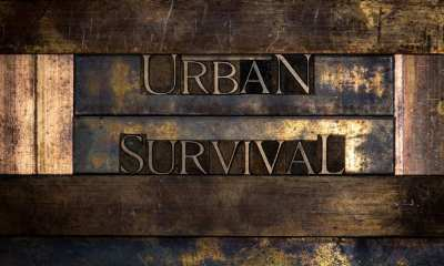 real authentic typeset letters Urban Survival text on vintage textured grunge copper-ss
