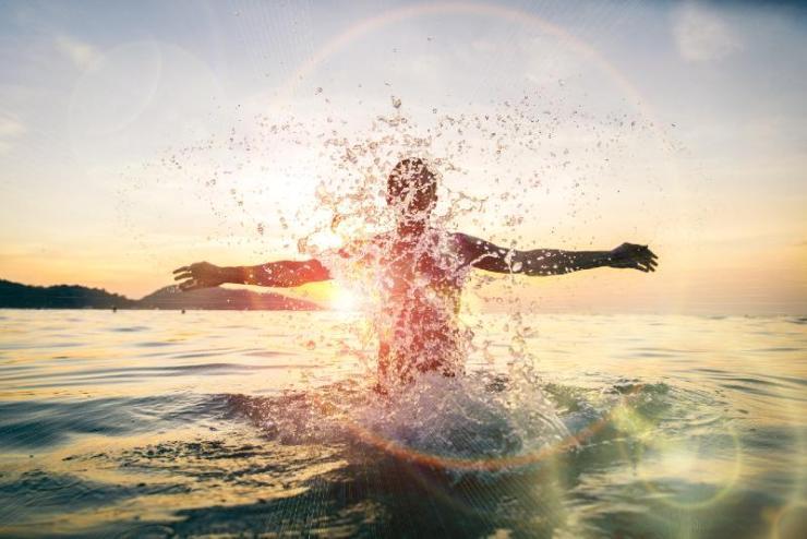 Man splashing water during summer holidays-sea survival