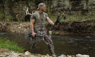 Bow hunter tracking prey   Summer in the Woods: How to Keep Cool While Hunting   featured