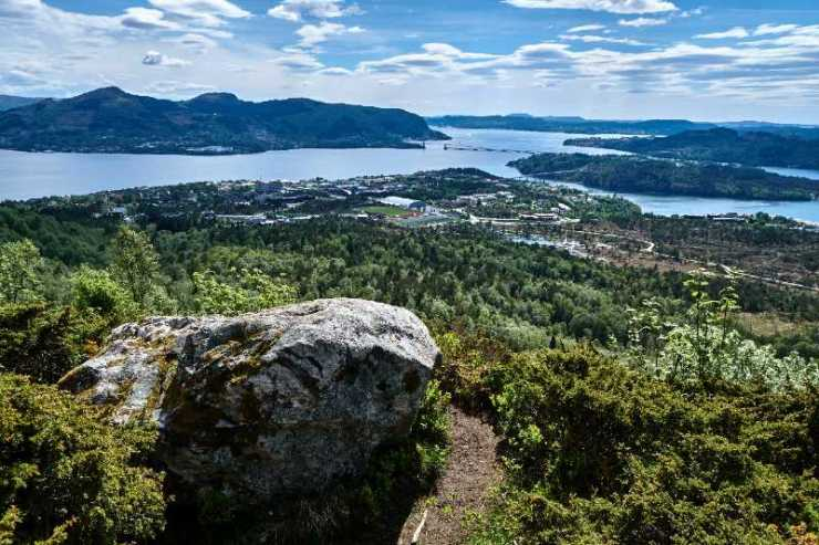 Spectacular view from a boulder. Hiking Mount Indregardsfjellet-terrain