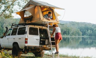 unrecognizable woman standing on ladder near boyfriend | Top 25 Car Camping Essentials | Featured
