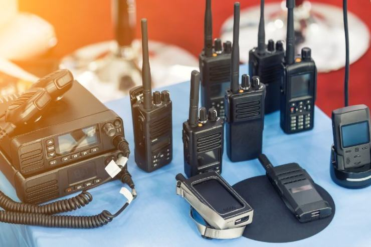 Many portable radio transceivers on table at technology exhibition-Emergency Radios