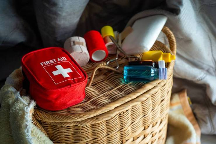 first aid kit bag on wood background, Medical concept, First aid equipment, First Aid Supplies-Medical Supplies