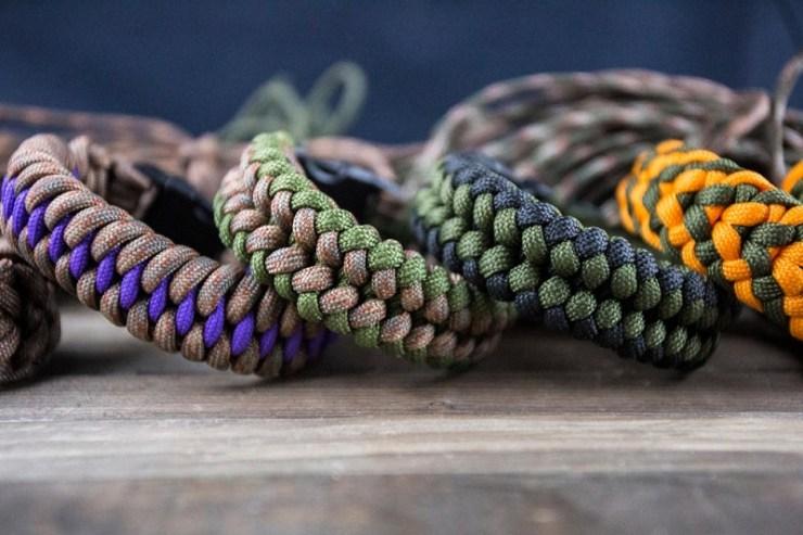 many-paracord-bracelets-on-wooden-background