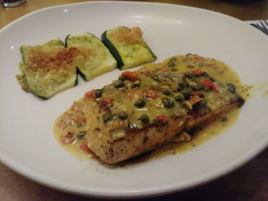 Image of Olive Garden's salmon piccata, a healthy choice.