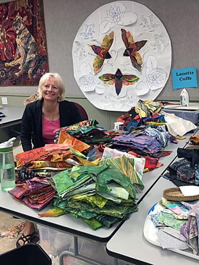 An awesome fabric stash for a colorful mandala by Lanette Cuffe.