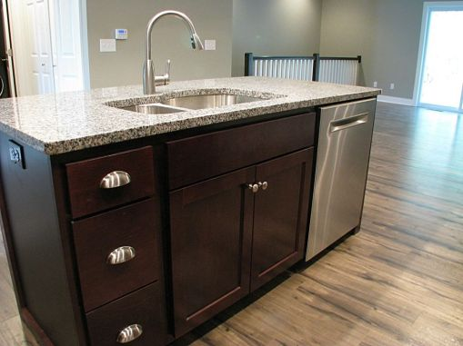 Center island with stainless steel sink with high rise faucet, granite counter top and stainless steel dishwasher