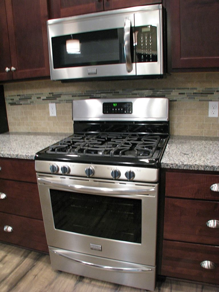 Stainless steel gas stove & built-in microwave.