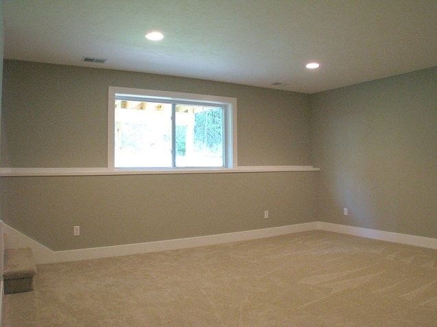 Another view of lower level family room with recessed lighting.