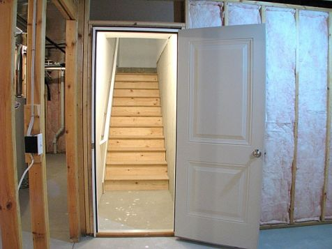 2-panel lower level leading to stairway to garage.