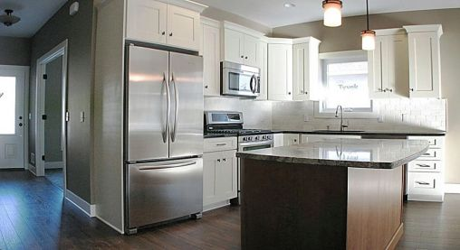 2447 Nuttall Court-Kitchen-Laminate wood flooring-Double door stainless steel refrigerator with freezer on the bottom.