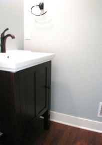 2447 Nuttall Court-Half bath with pedestal vanity, hard surface counter, and oil rubbed bronze high rise faucet
