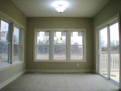 3 season room with panoramic windows overlooking the back yard