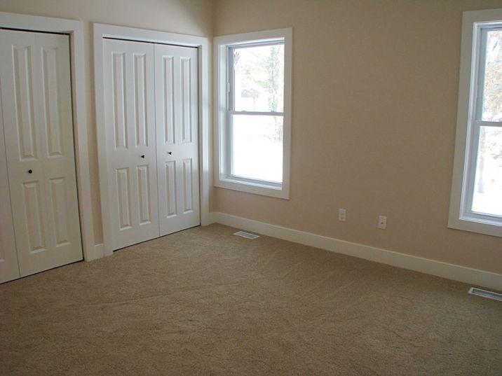 Master bedroom with double bi-fold 4 panel doors