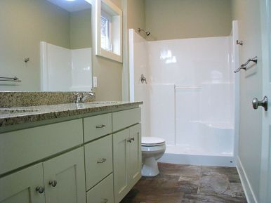 Master bath with step in tub & privacy window
