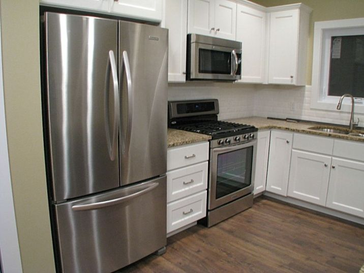 Double door refrigerator with freezer on the bottom..