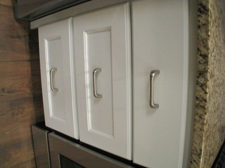 Lower cabinets with hardware handles.
