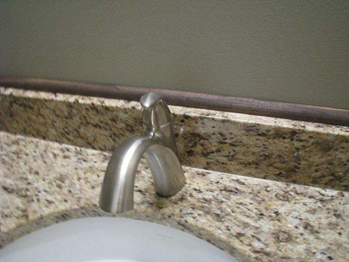 Brushed nickel faucet in half bath.