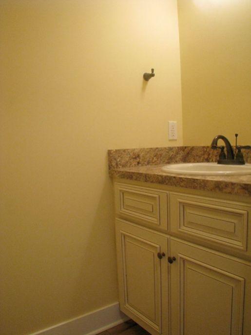2433 Half bath, white cabinets with laminate counter