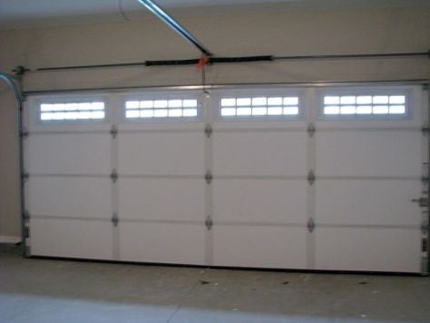 2433 Two stall attached garage with insulated garage door