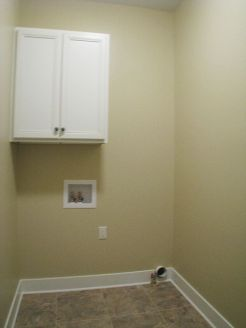 2502 Laundry with storage cabinet and hanging clothes gar