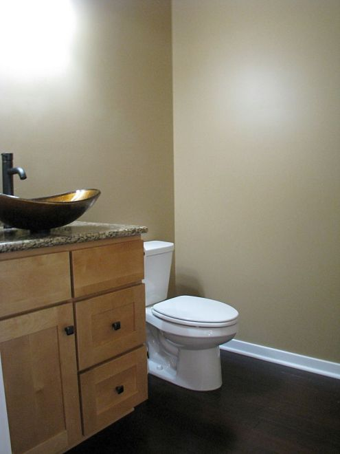 2437 Half bath with elongated seat on toilet