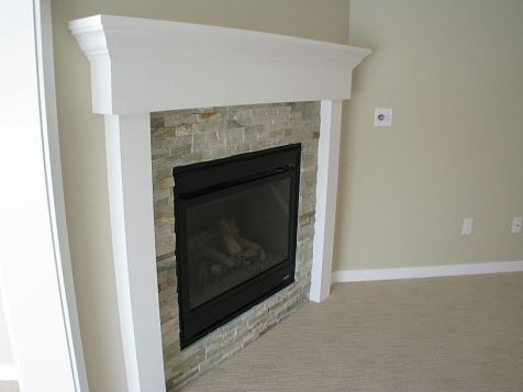 2518 Living room fireplace - button on wall to start gas logs in fireplace