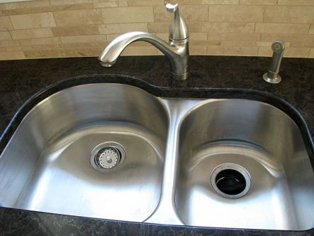 Double sink and brushed nickel high rise faucet
