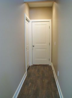Unit 2515 Hall leading to back entry door and closet | Sawgrass Condos in Holland, MI