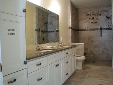 Vanity and linen closet in master bath