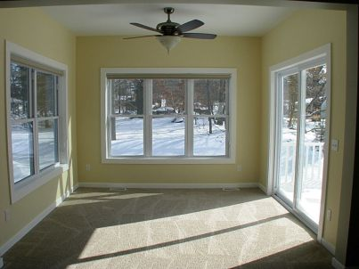 4 season room with lighted ceiling fan
