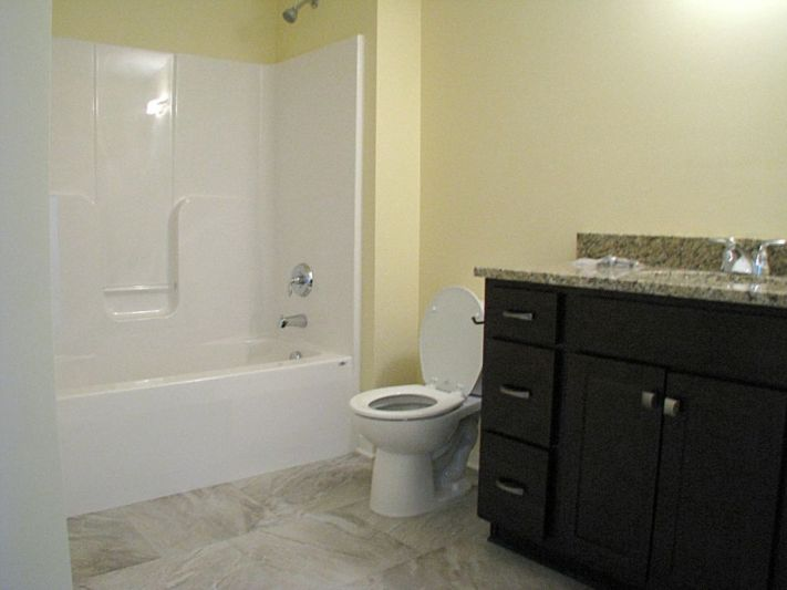 One piece tub/shower combination