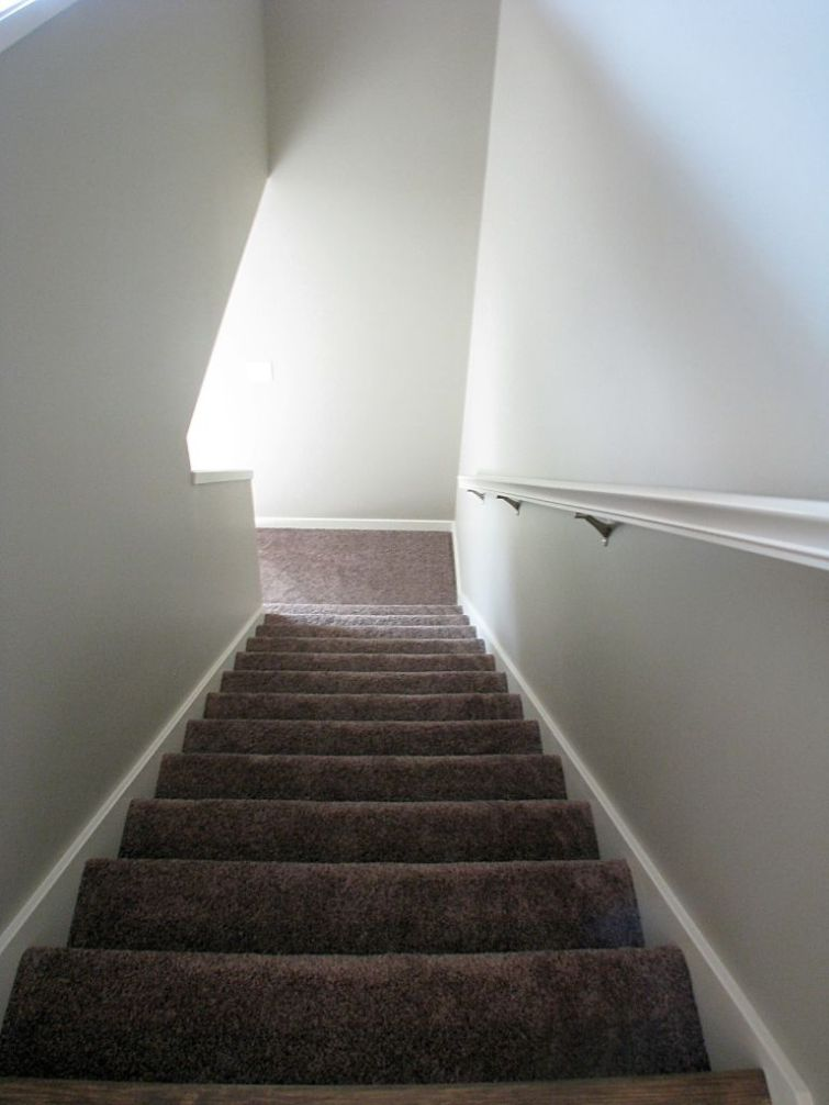 Stairway from living room to lower level