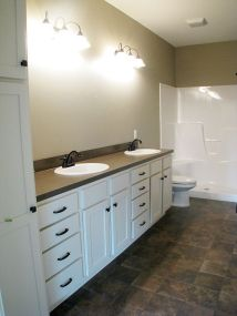 Master bath with linen closet and double sinks