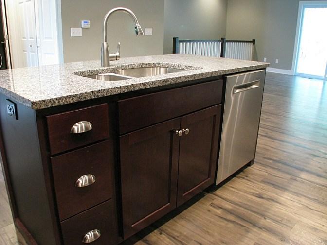cabinet island dark wood and granite