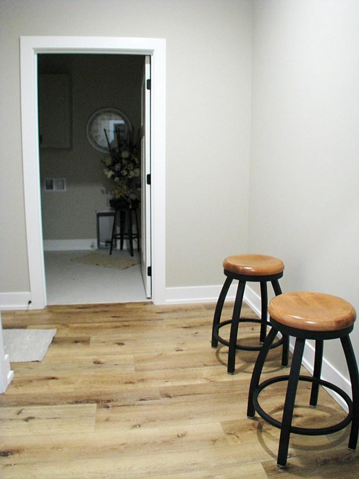 Mud room hall to half bath by back door