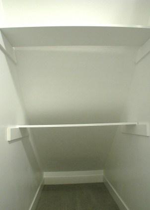 closet shelving under stairs