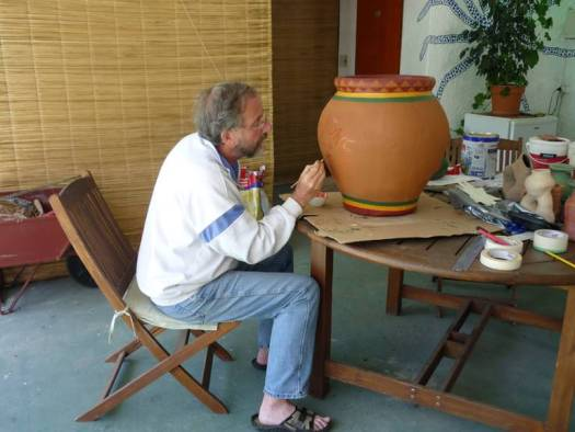 Syd Blackwell painting a flower pot