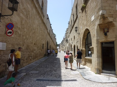 Knight Street connects the Palace and harbor. Inns or residences by nationality and language of the knights line the cobble street