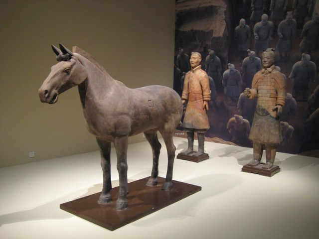 Terracotta horse and two soldiers from the Terracotta Army buried near the Mausoleum of the First Emperor of Qin, at Lintong, Shaanxi Province, 1974. Wikicommons: photographer, Babelstone.