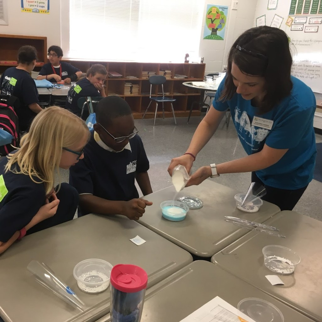 Susanna Harris is demonstrating a science experiment to children.