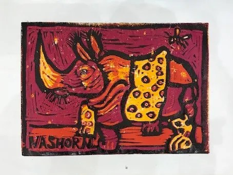 18 Entstehung Nashorn mit gelber Decke, Linolschnitt von Susanne Haun (c) VG Bild-Kunst, Bonn 2021