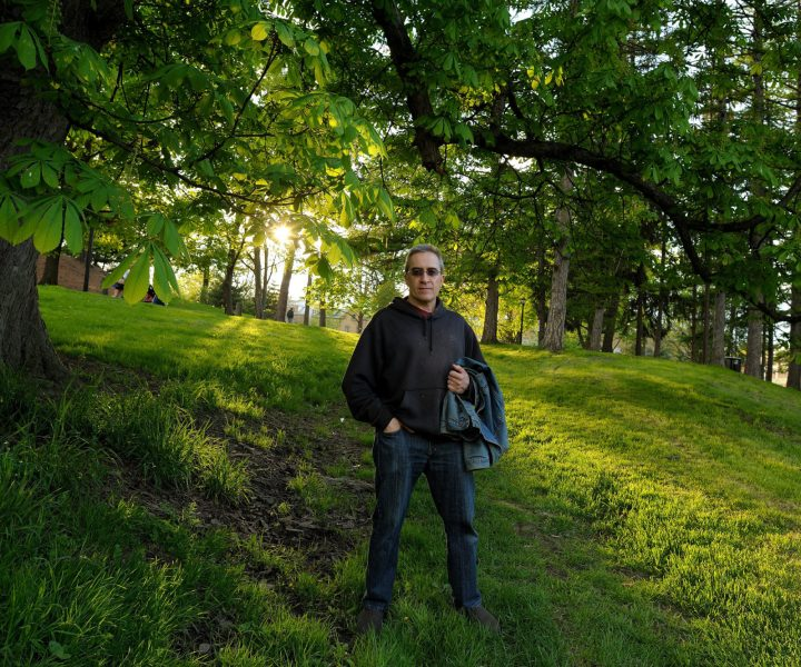 We were leaving the Tulip Festival in Albany in 2013 after a rain--as we were leaving, the sun breaking through made the grass and trees glow--I asked Don to walk up the hill a bit and took a quick shot.