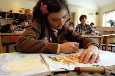 Girl with star barrette coloring, Rudolf Steiner School